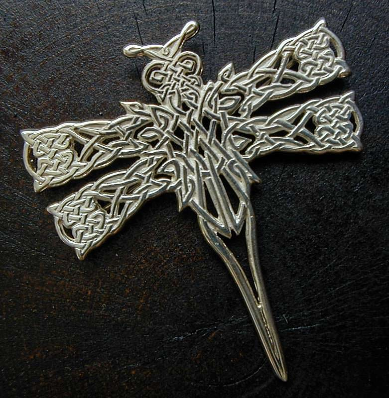 Original Celtic knotwork dragonfly design cast in silver with pin backing.