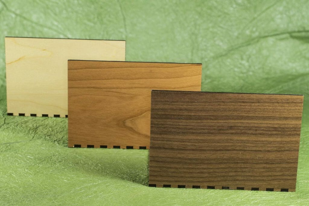 Magnetic hardwood pop up card stands in maple, cherry and walnut.