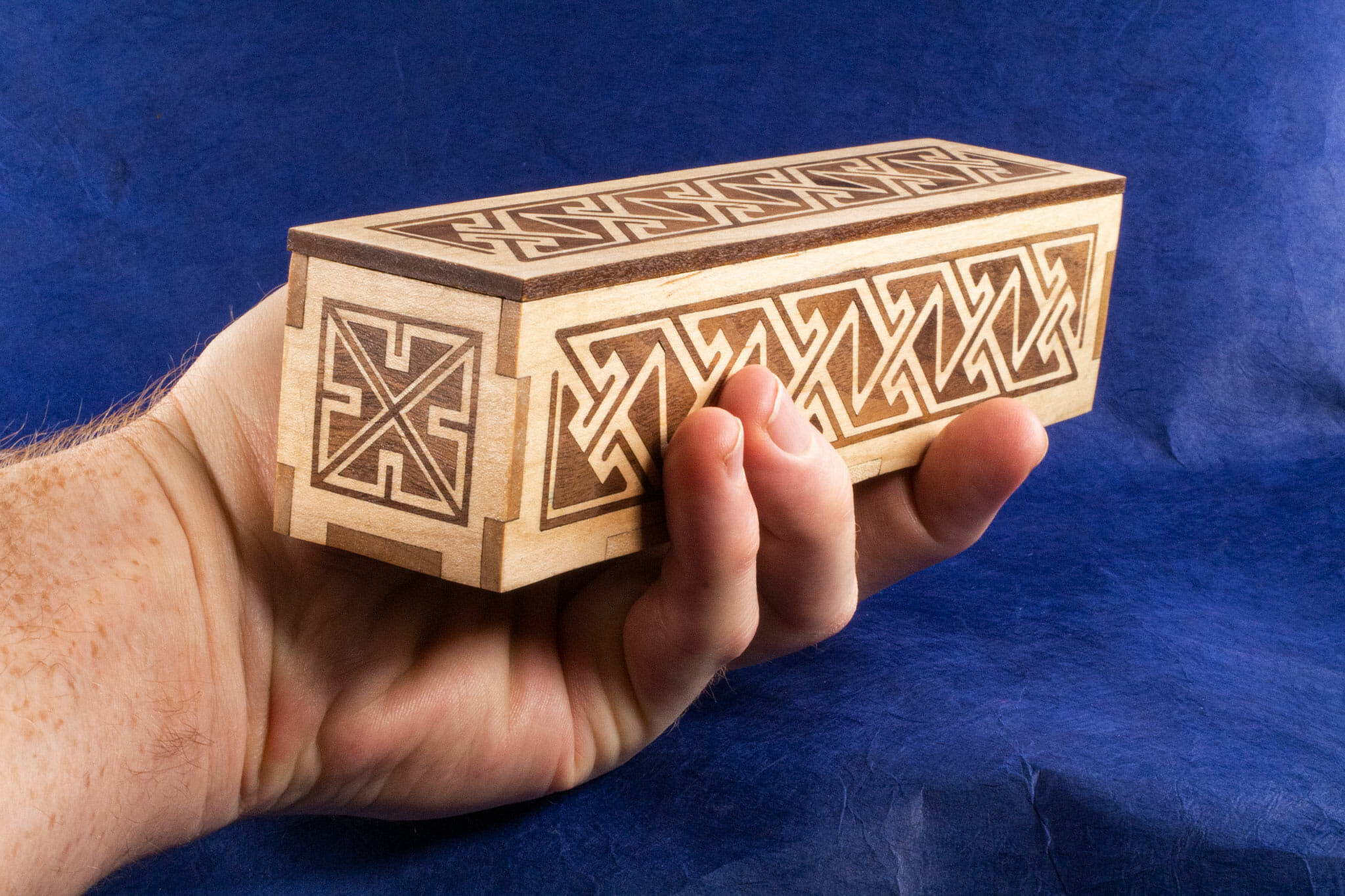Long Inlaid Celtic Key Pattern Box (hand-held for scale)
