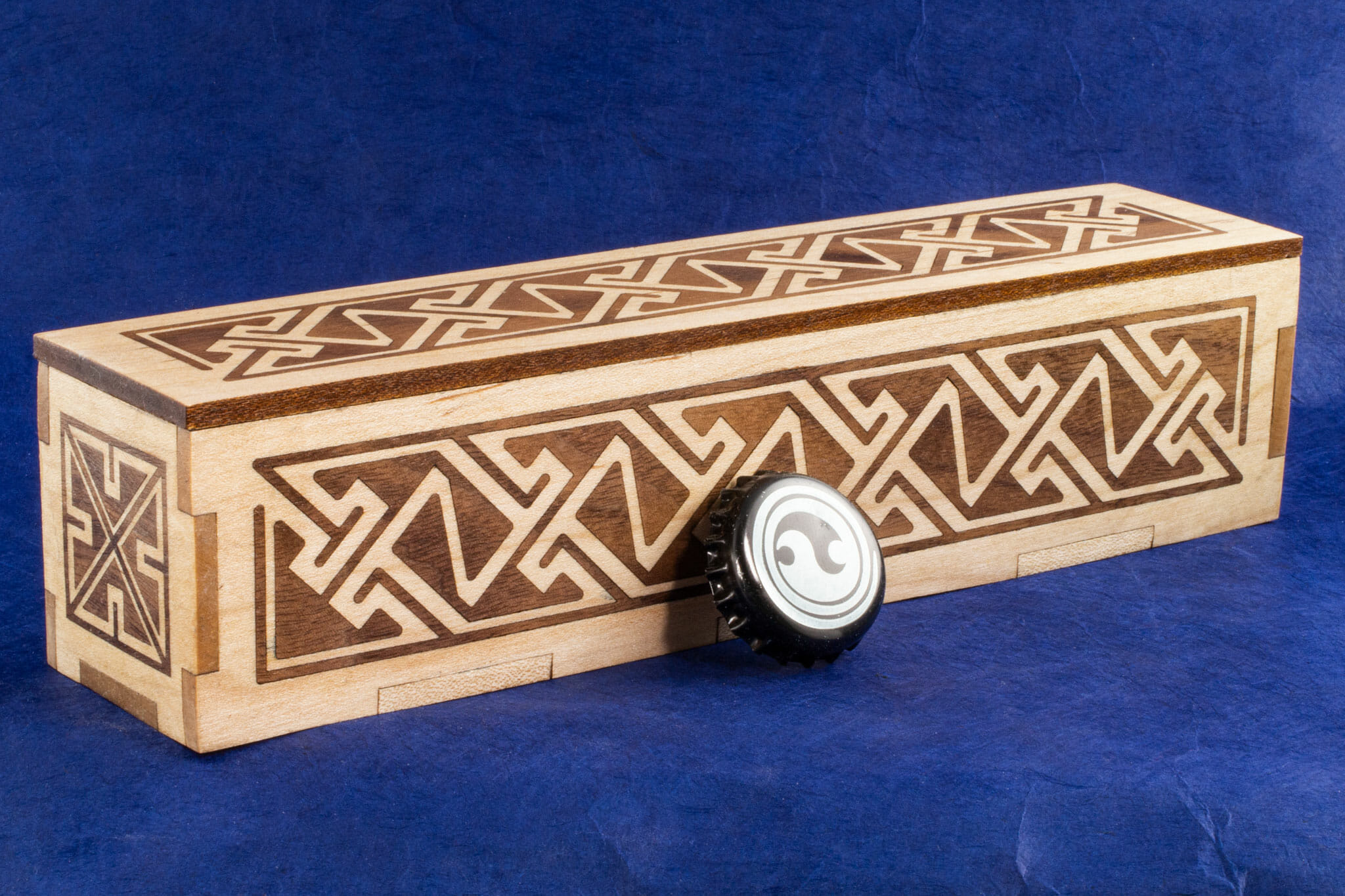 Long Inlaid Celtic Key Pattern Box (with bottlecap for scale)