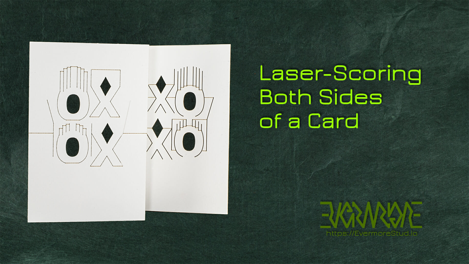 Laser-scoring both sides of a card