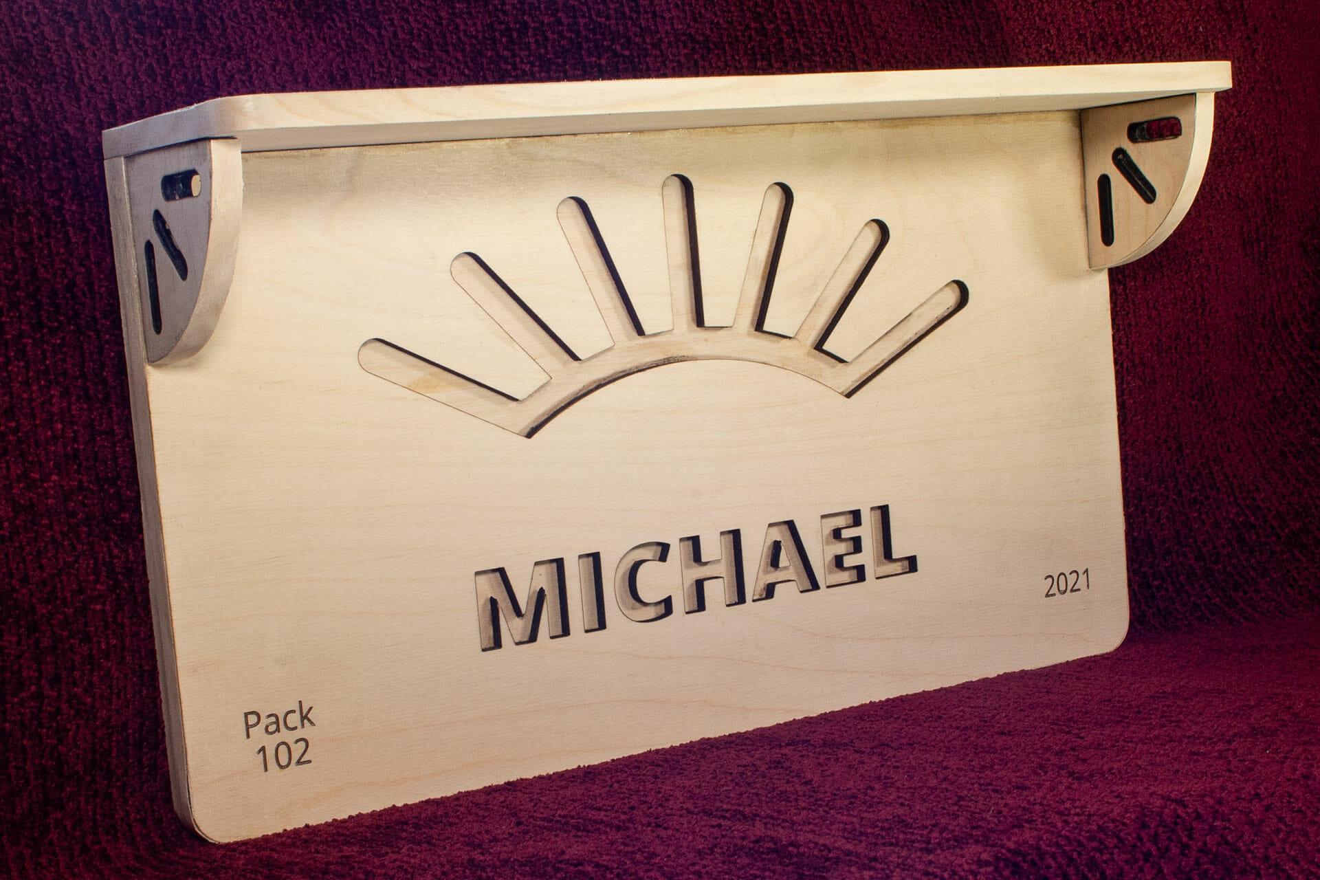 Arrow of Light plaque + shelf (3/4 view left)