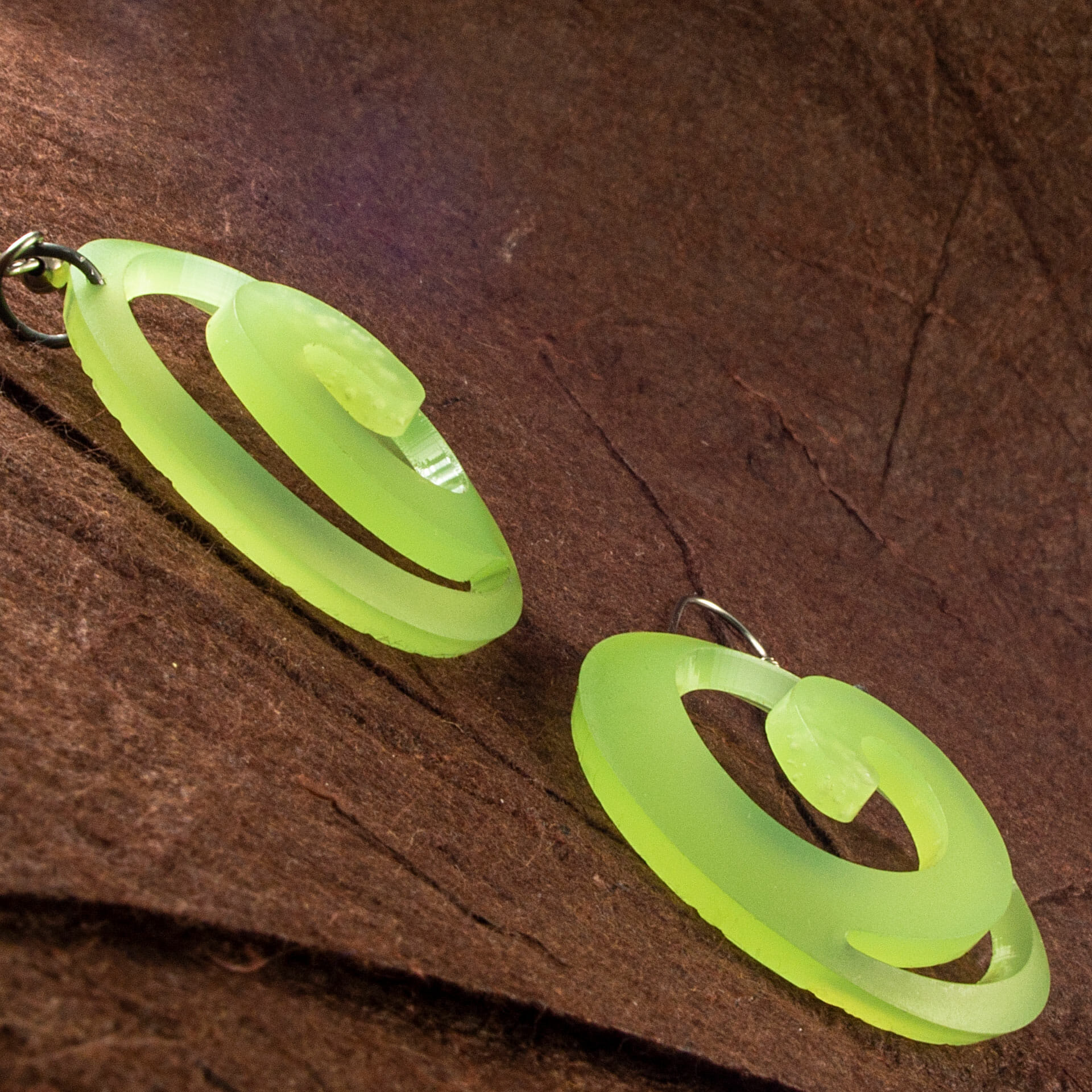 Translucent Kiwi Green Dished Acrylic Spiral Earrings (side view)