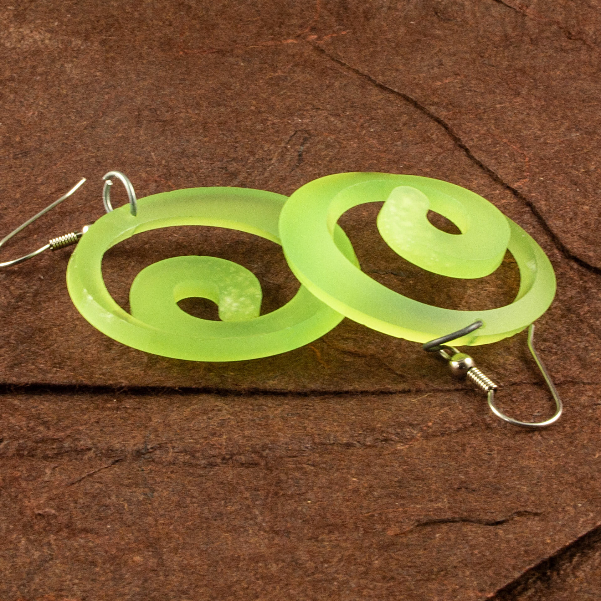 Translucent Kiwi Green Dished Acrylic Spiral Earrings (Front and Back)