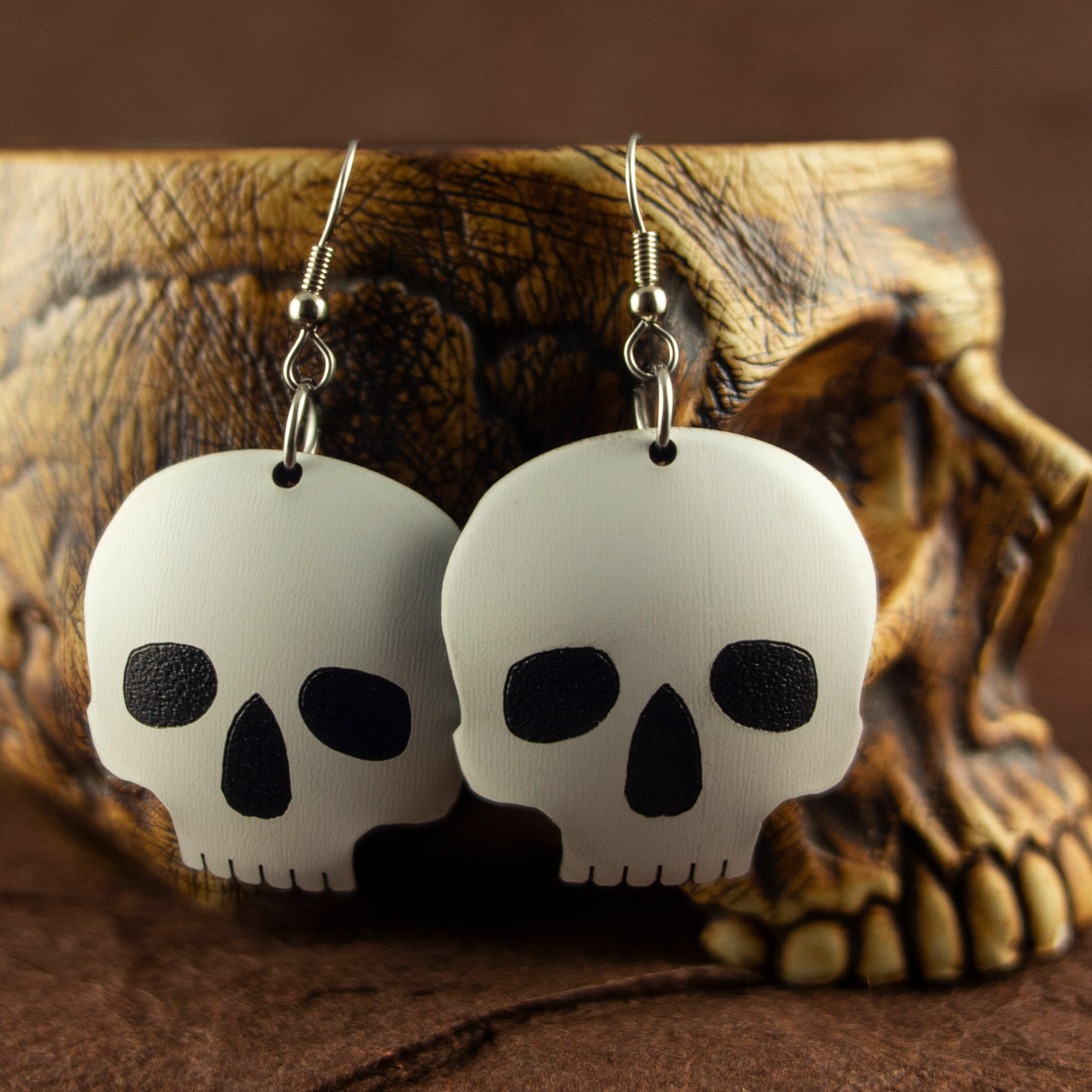 Two-Toned Dished Acrylic Skull Earrings