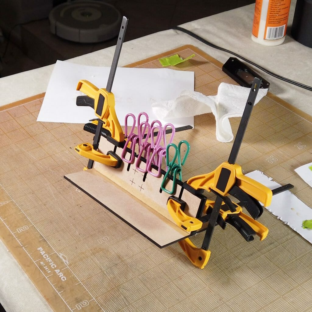 Floss separator, clamped for glue to dry